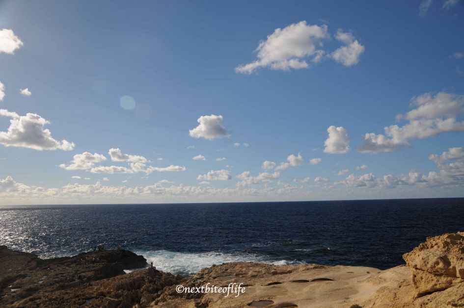 gozo view of crashing waves from the sea and rocks
