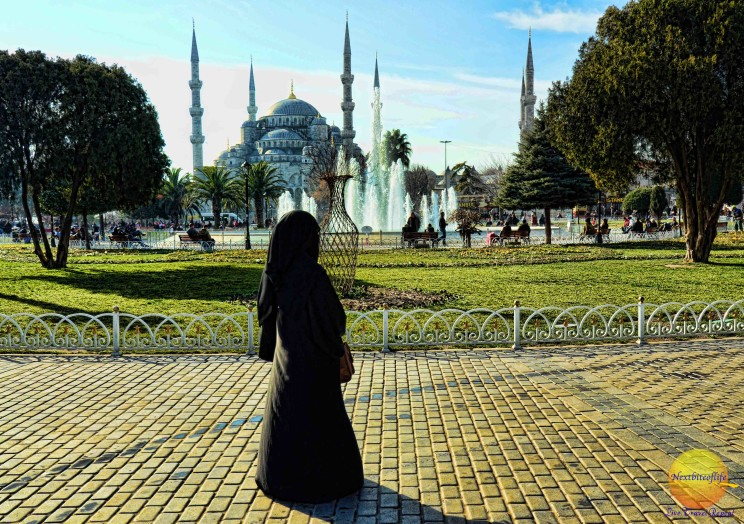 Istanbul Turkish delight - image of a woman in a burka against the backdrop of the Hagia Sophia.