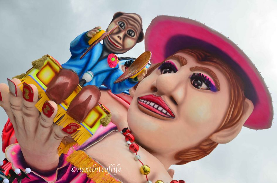 carnival malta float big female head with brass monkey on cymbals