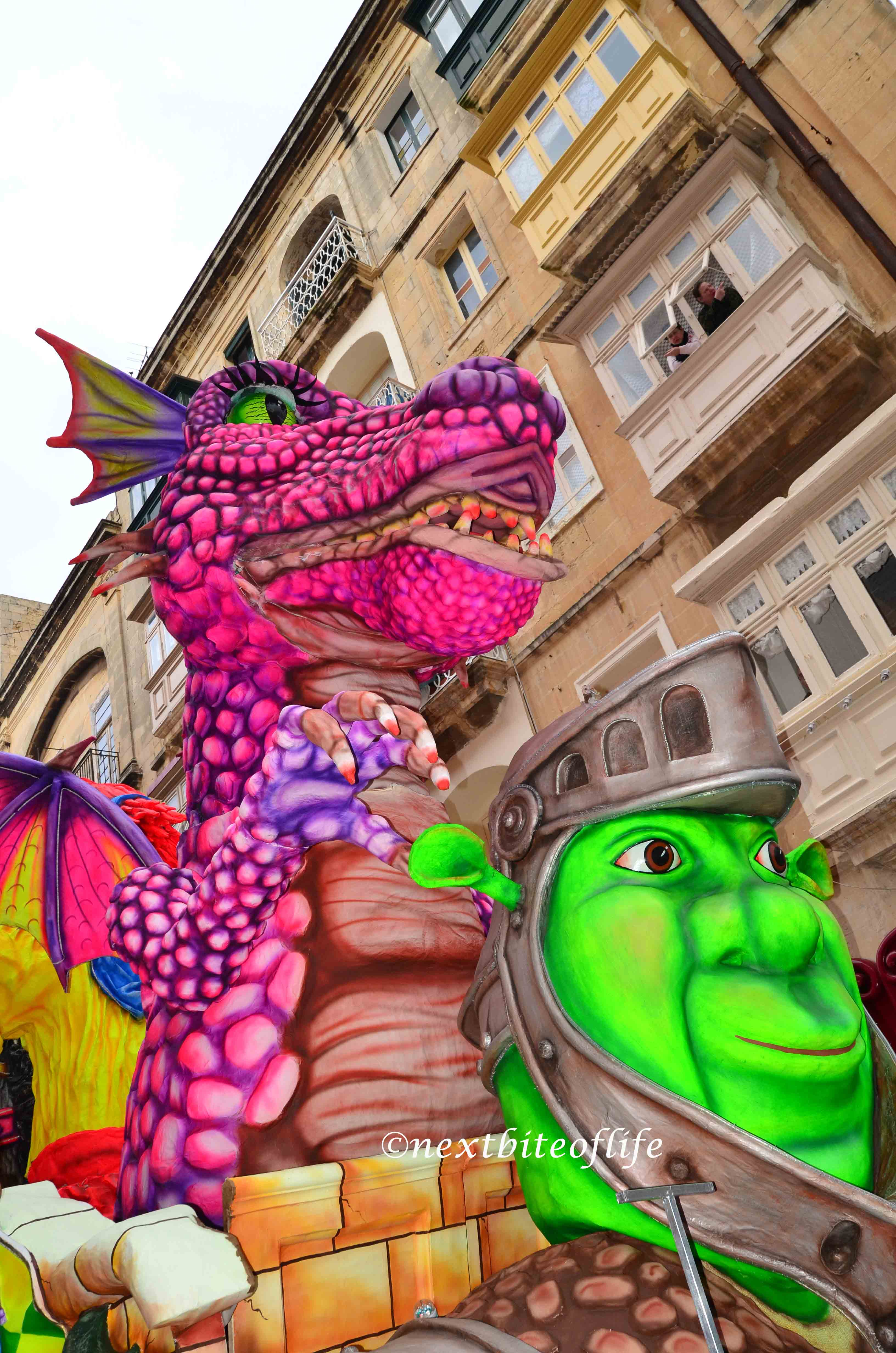 shrek at the malta carnival with the dragon above him