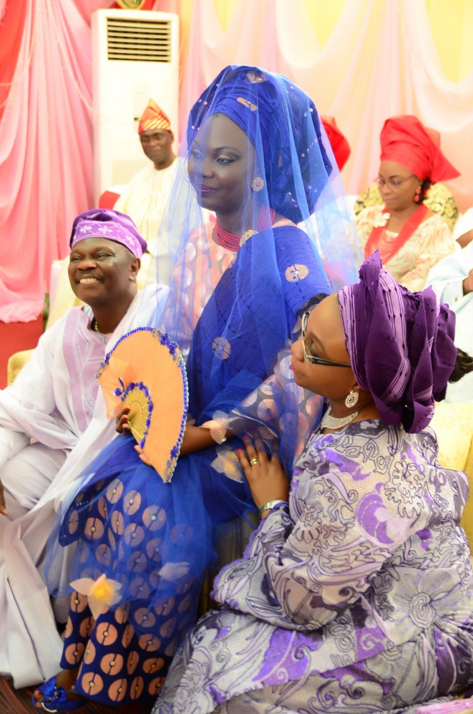 The bride's parents accepting and getting ready to send her off to the other side (where the groom's family is)