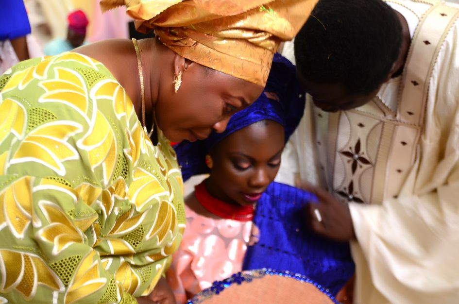 The groom's parents welcoming their new daughter with some tears and a prayer