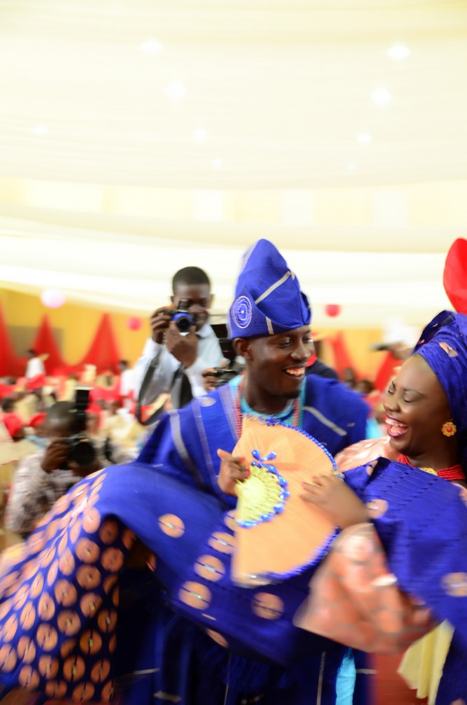 Nigerian bride being swept off her feet by the groom and she is laughing!
