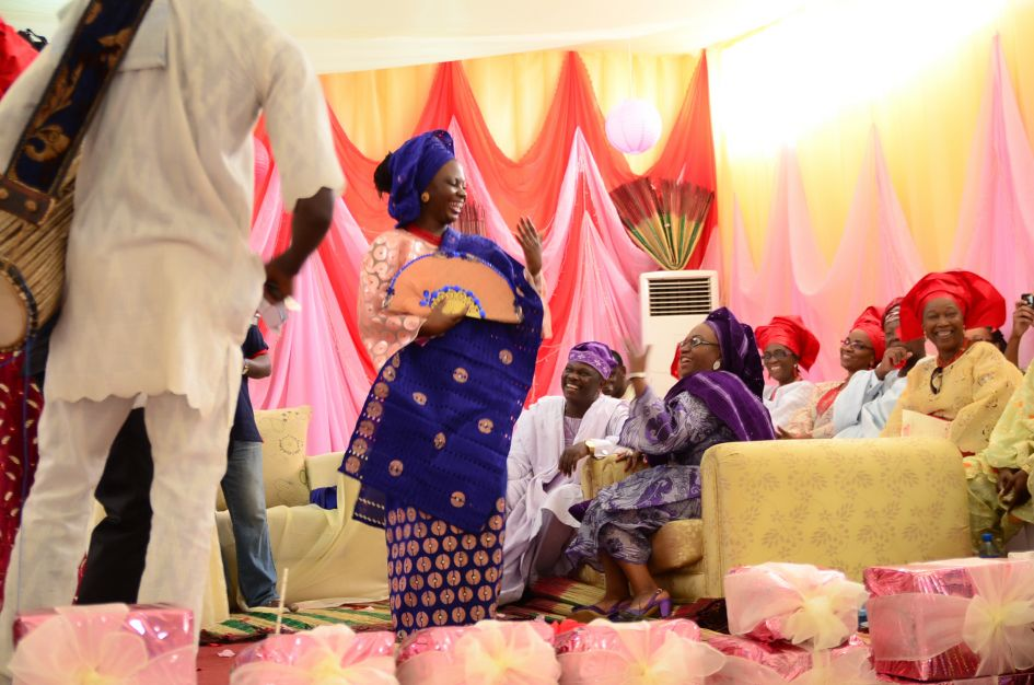 traditional west african engagement - bride showing off ring