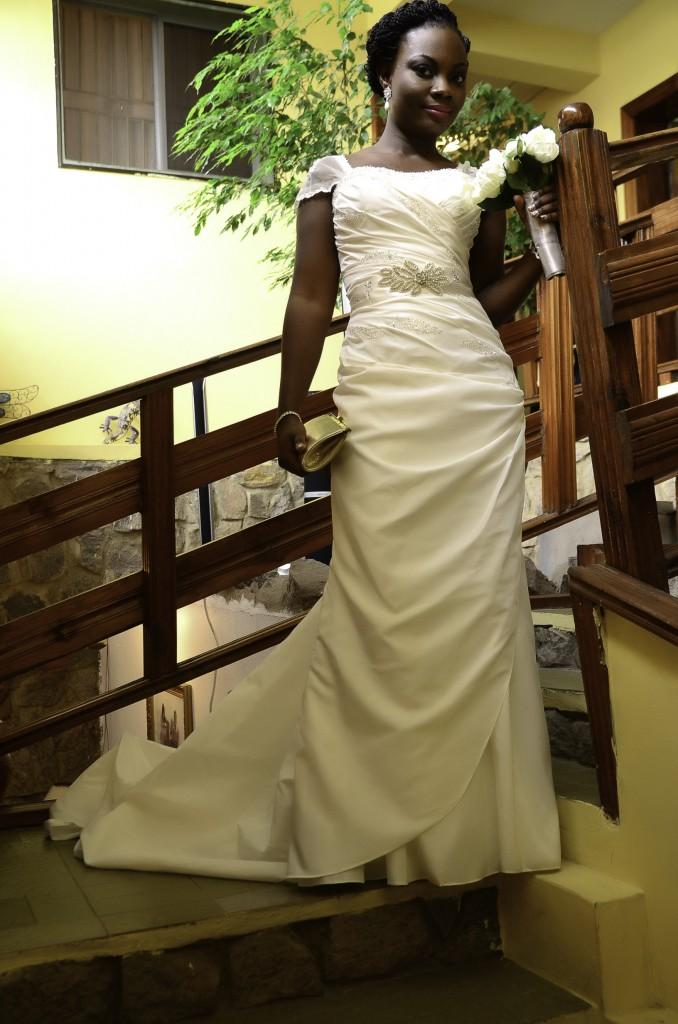 brdie in white gown posing on stairs in Nigerian wedding