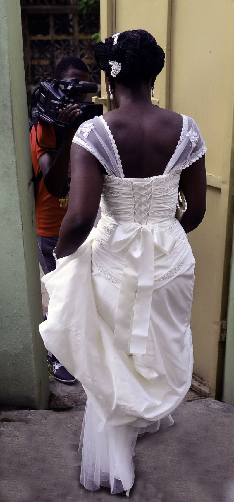 Bride walking away showing the back of wedding gown