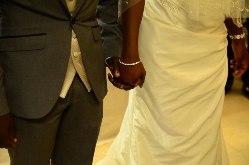 pic of bride and groom holding hands