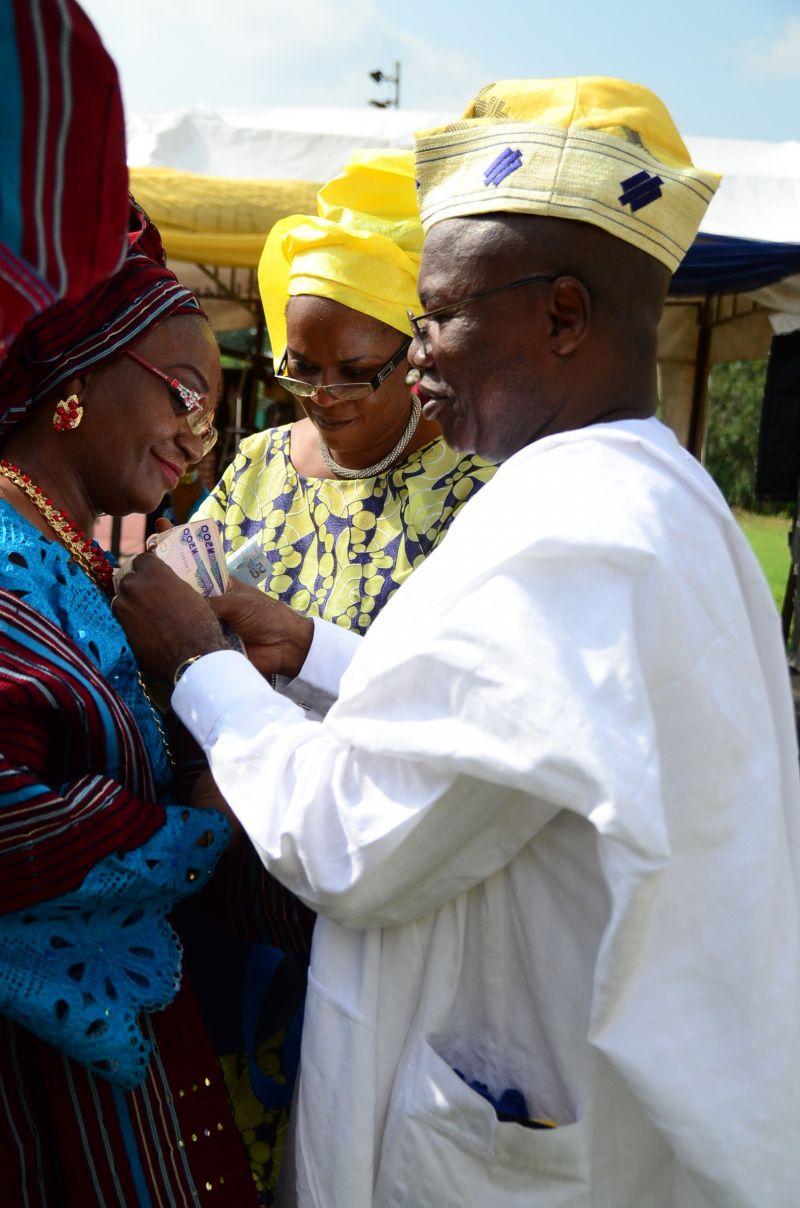 The brides mom being sprayed on a Nigeria wedding day event