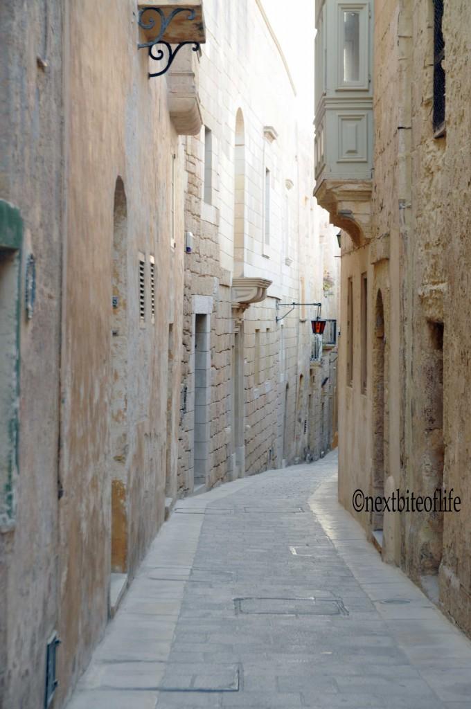 Mdina, narrow street and Maltese window in malta