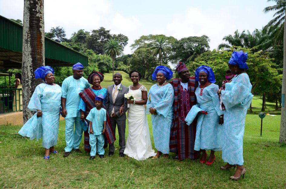 Groom's family at Nigerian wedding all in blue outfits native