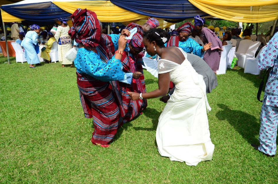 Nigerian bride dancing with her mom