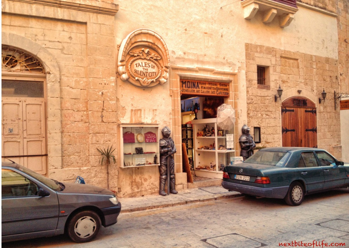 mdina malta souvenir shop with iron knights in front