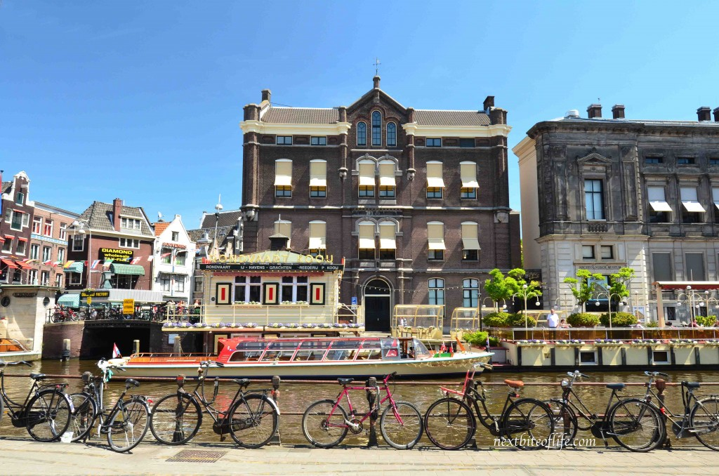 bikes by canal amsterdam