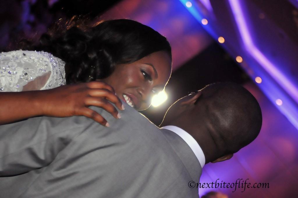 black bride and groom dancing