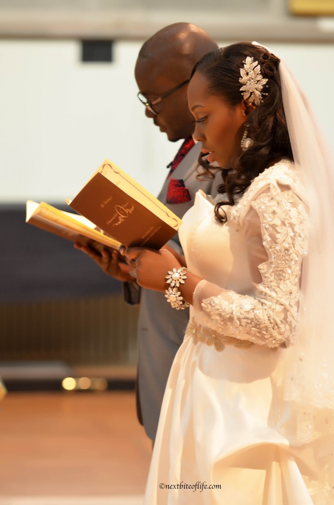 black groom and bride reading bible at wedding