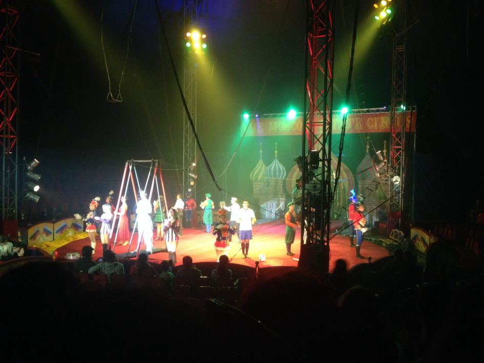 Moscow state circus performers on circus stage and dim lights