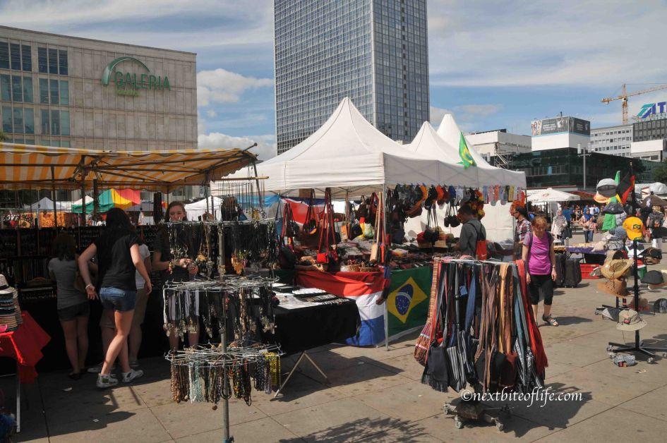 Alexanderplatz flea market in Berlin selling bags stands