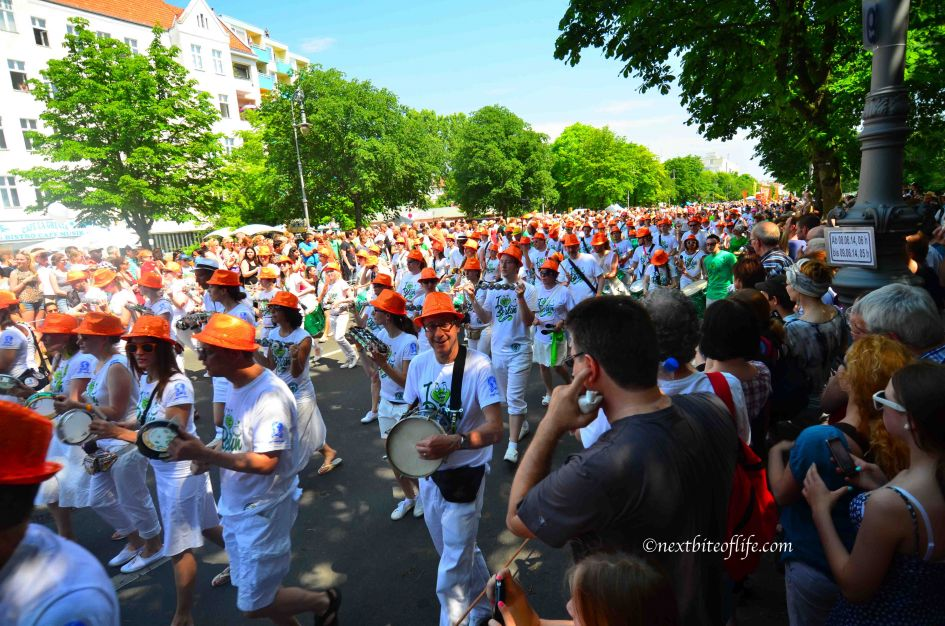 Berlin carnival of culture walkers in white shirts and orange caps Berlin