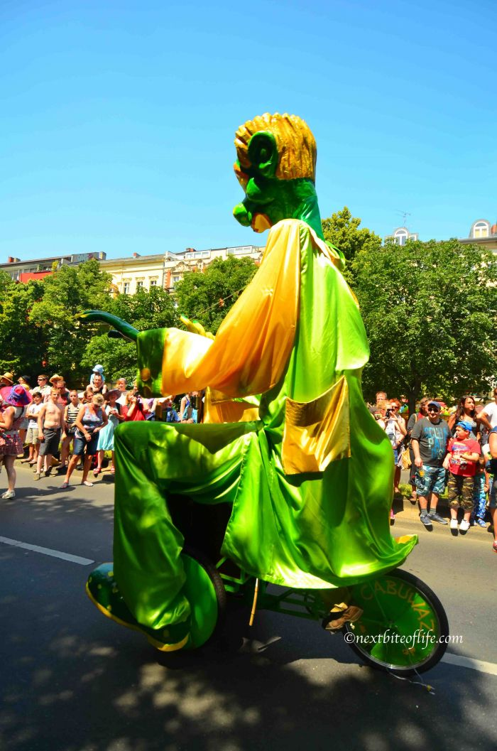 Berlin carnival of culture - green giant riding a bike