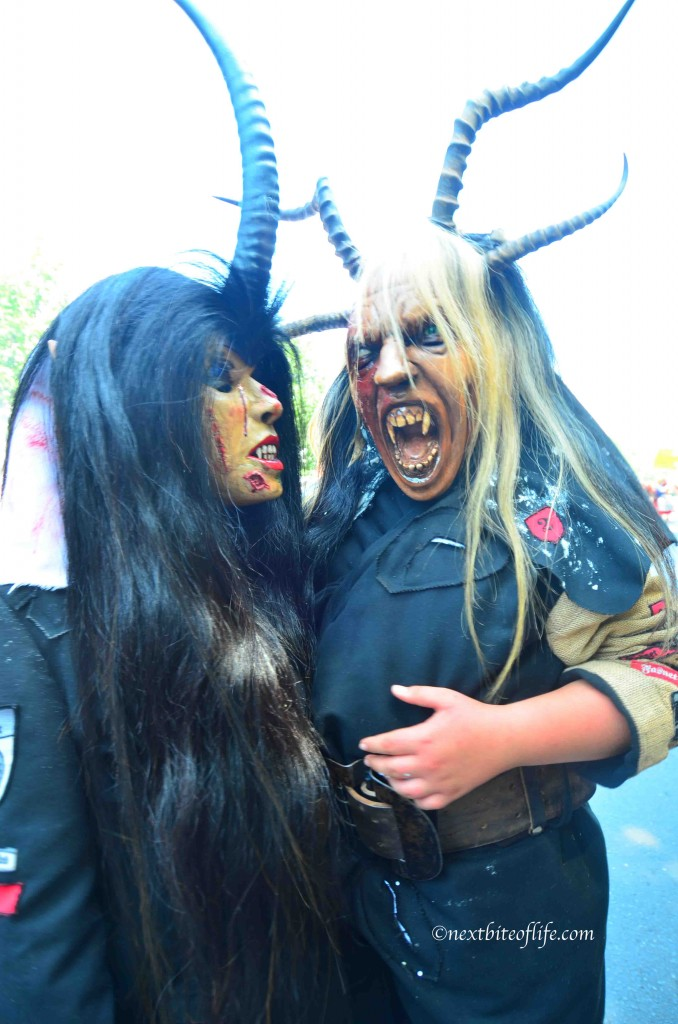 Ugly costumed man and woman with horns carnical of culture Berlin