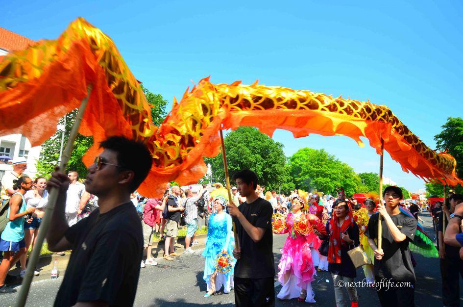 Chinese float at carnival..orange long dragon held afloat