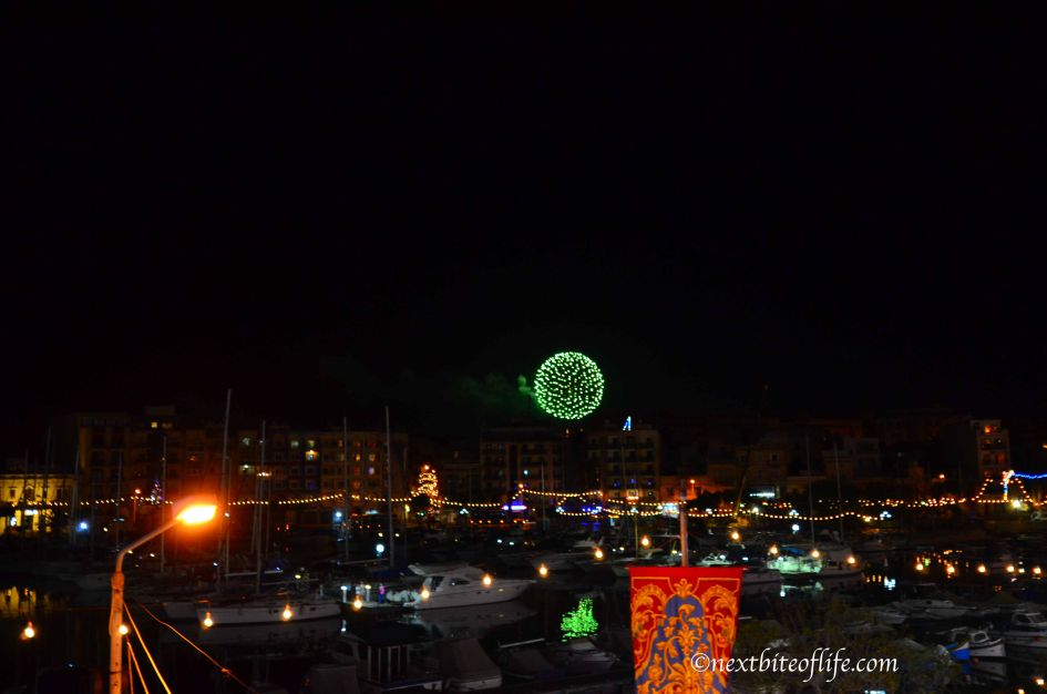 Green fireworks going off over the Msida marina in Malta