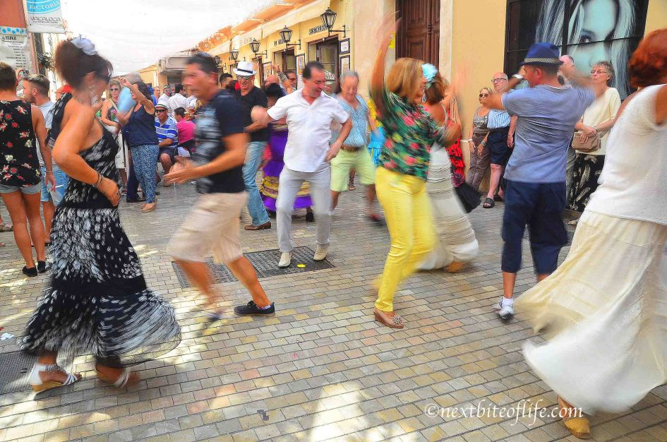 feria malaga activites - people dancing in the streets