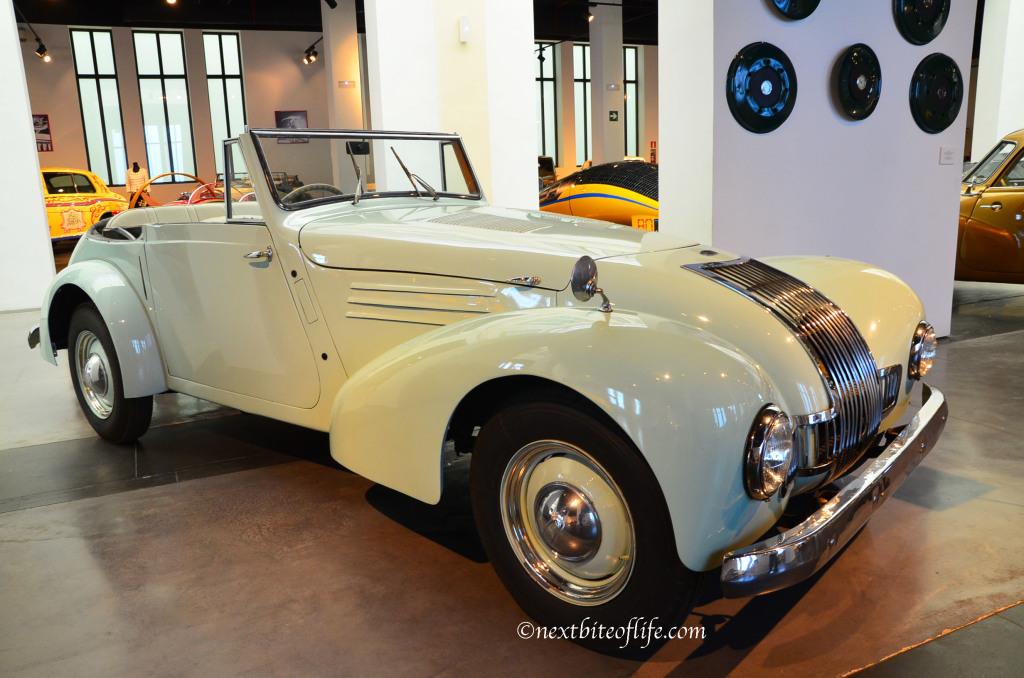 classic cream colored buggy at auto museum malaga