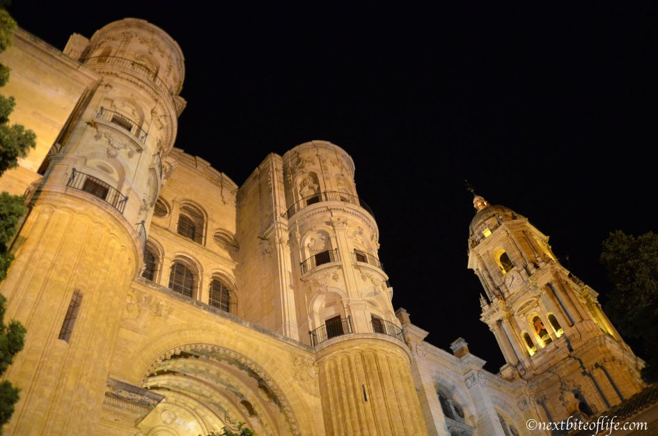 Malaga cathedral up close view from the bottom at night with tower