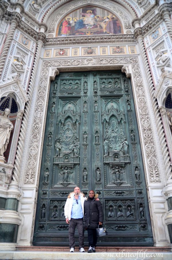 posing couple in front of green door Duomo Florence