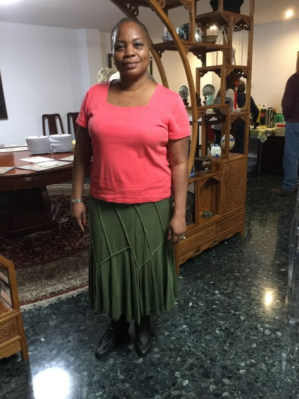 woman with pink shirt and green skirt