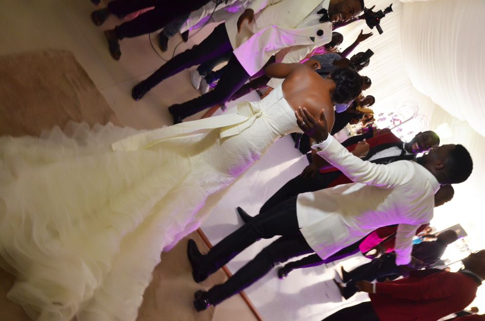 back of nigerian bride wedding dress and husband