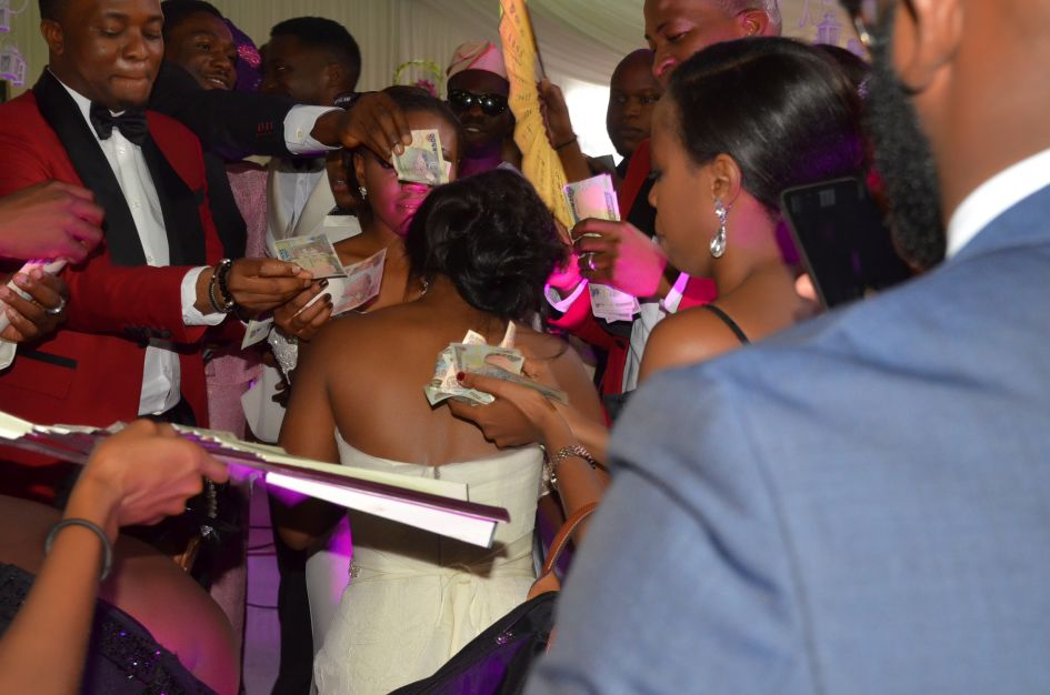 """""""spraying"""" the bride while dancing at a nigerian wedding"""