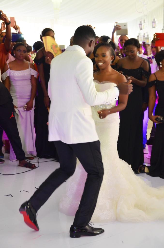 image of groom and bride dancing at nigerian wedding celebration.