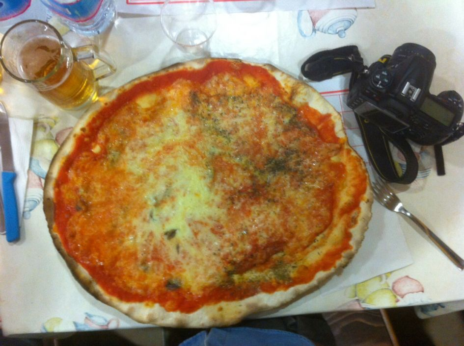 His pizza, wise choice. He says you can tell how good a pizza place is by ordering the margherita..