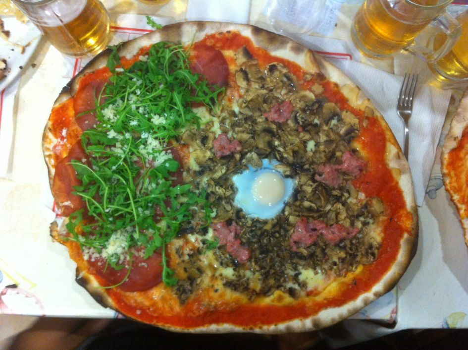 Pizza with toppings at I Girani Roma