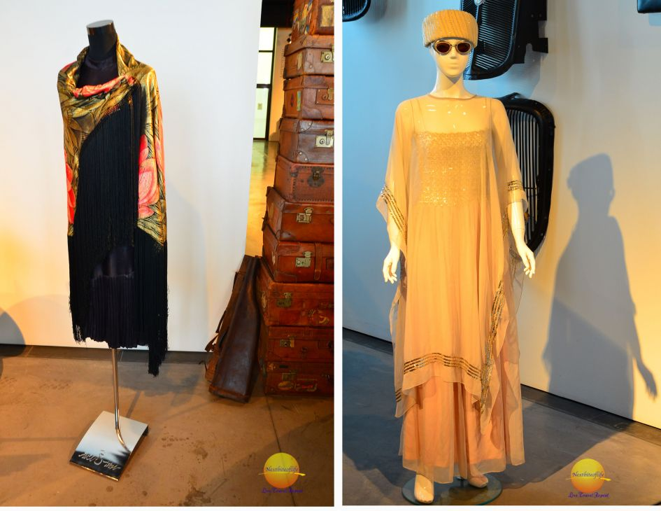 fashion at malaga fashion museum, black dress with scarf and gold caftan dress with matching bowl hat