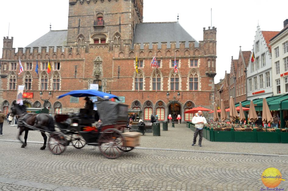 bruges carriage in front of the bellfry