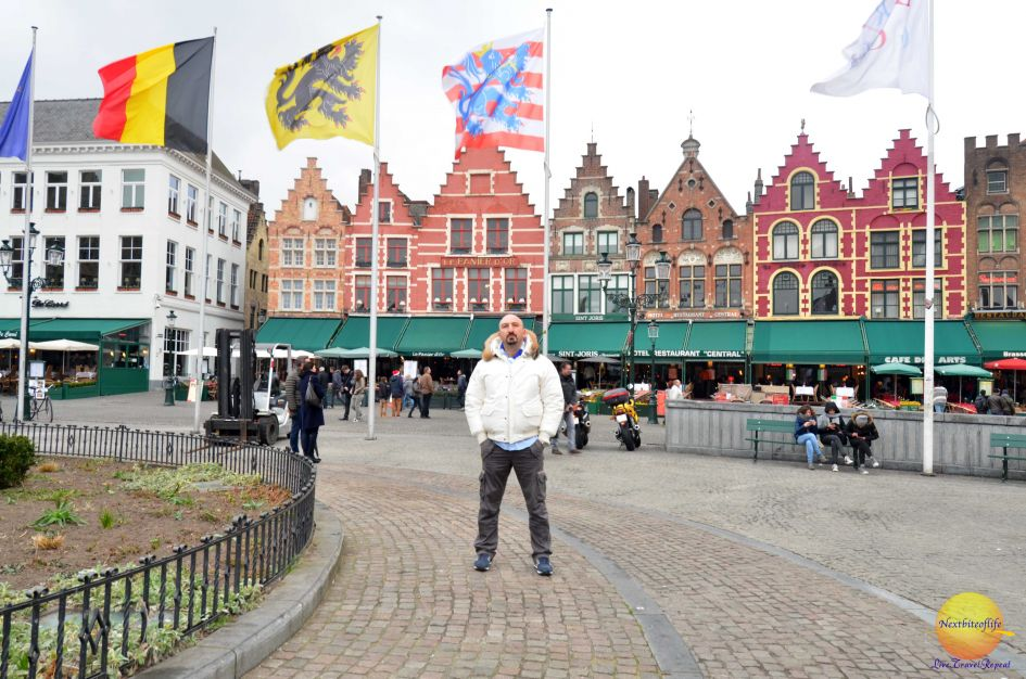 dam square bruges belgium with guy posing
