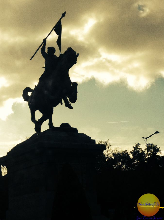 horse statue with man against cloudy skies seville spain