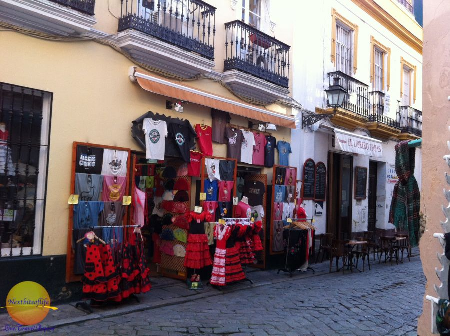 souvenir items in front of Seville store. dresses, tee shirts aprons etc