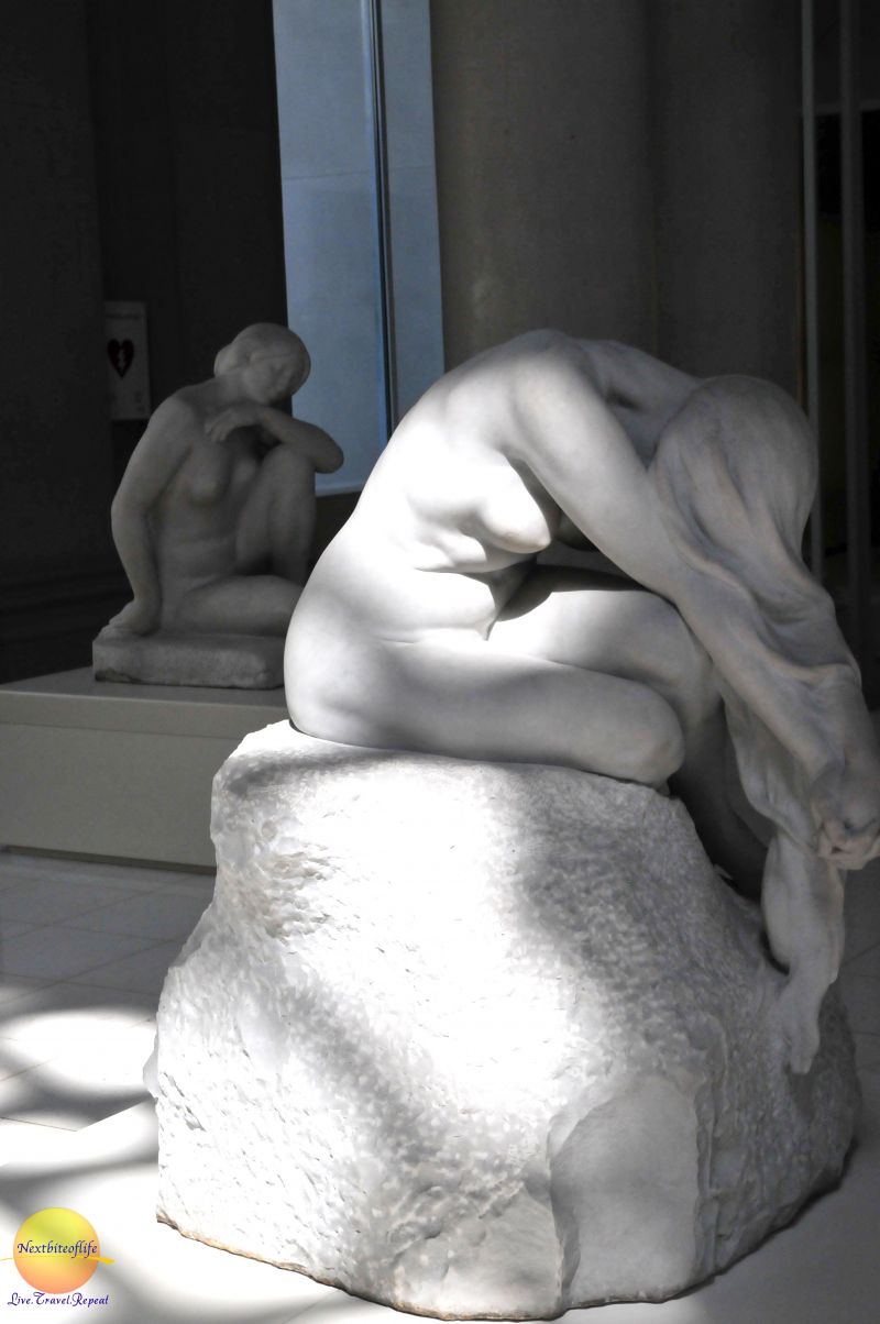 marble sculpture of naked woman cascading hair sitting on stone. #MNAC #Barcelona