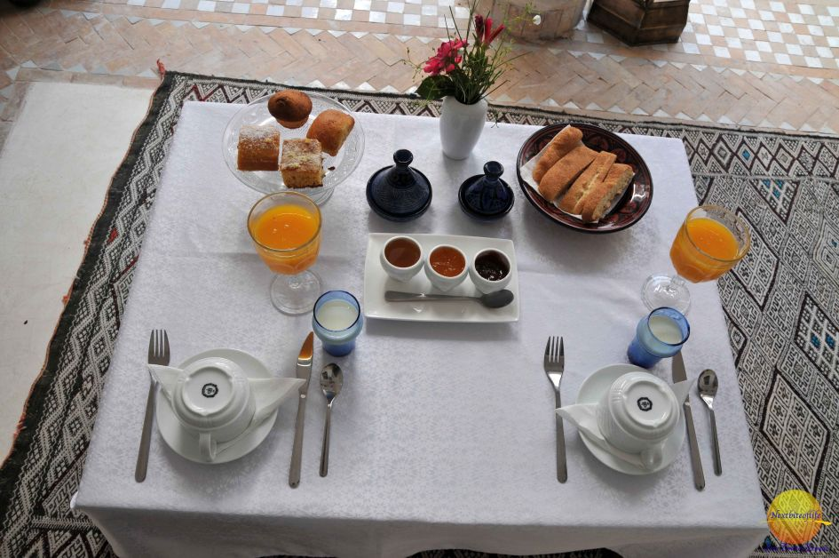 Traditional Moroccan breakfast at Riad Farhan Marrakech with bread, honey, fruit