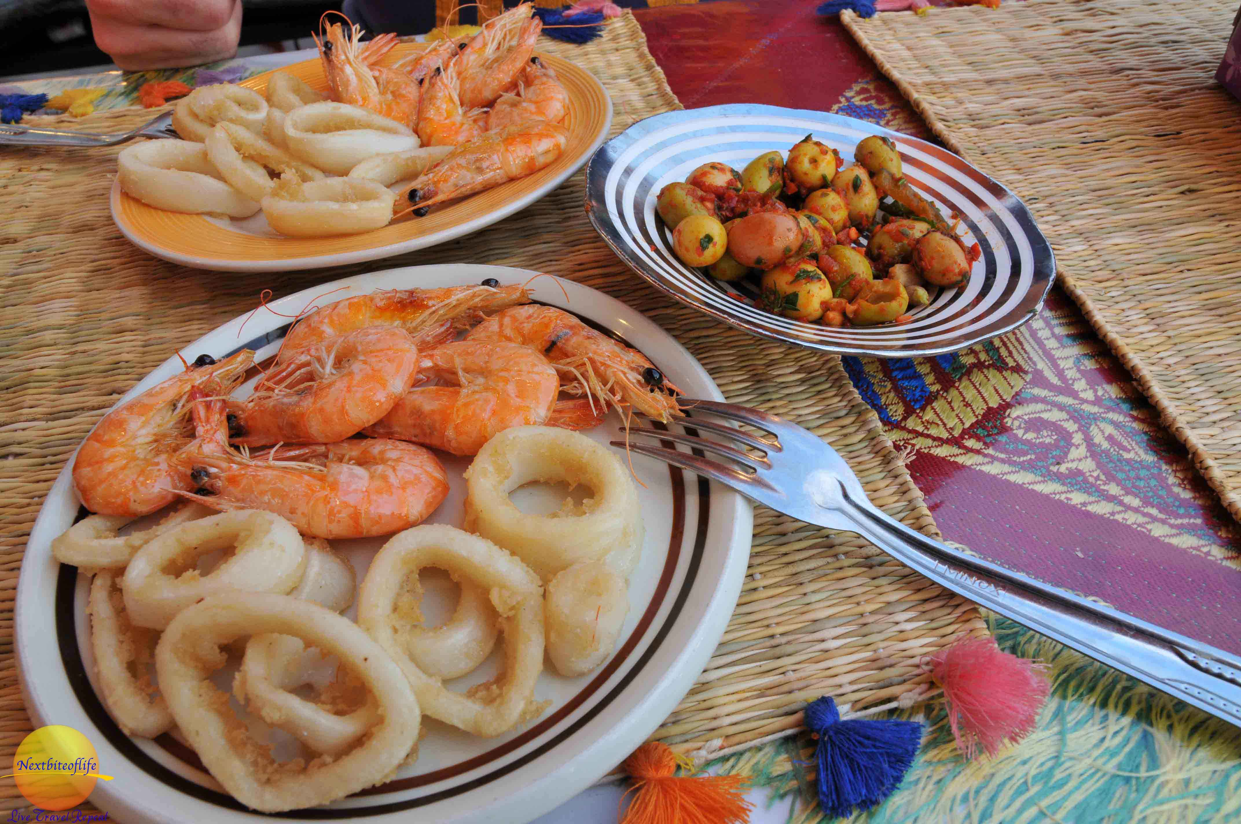 Yum..yum.. seafood and olive platters in marrakesh souk
