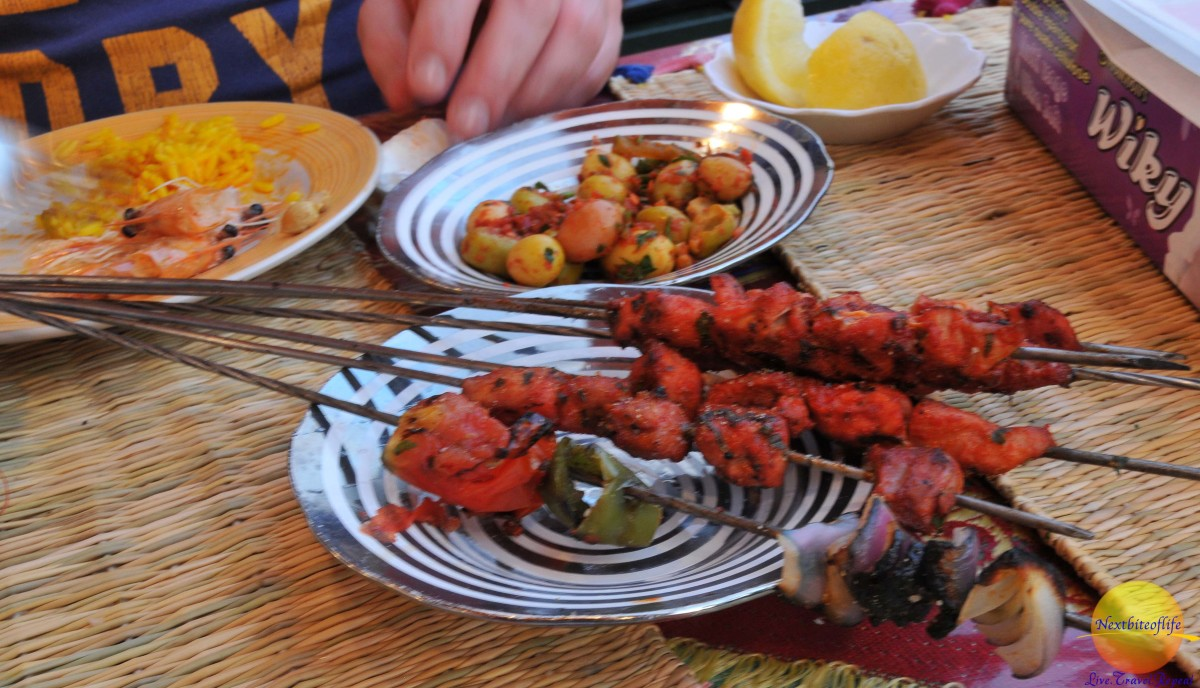 olives and skewered meat in marrakech