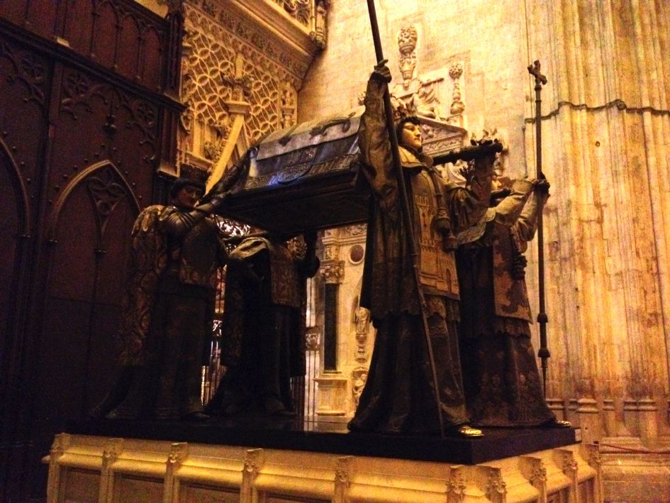 Christopher Columbus tomb 2 at Seville Cathedral carried by four men.