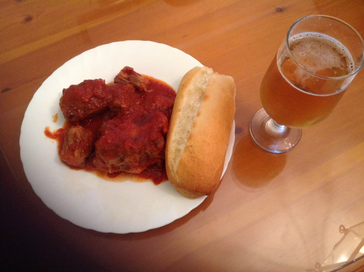 seville cost of living oxtail and beer plate