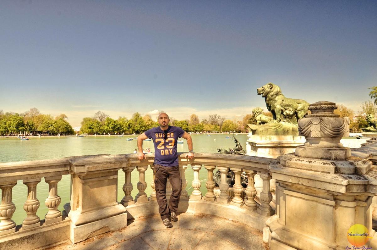 man at el retiro park with water view