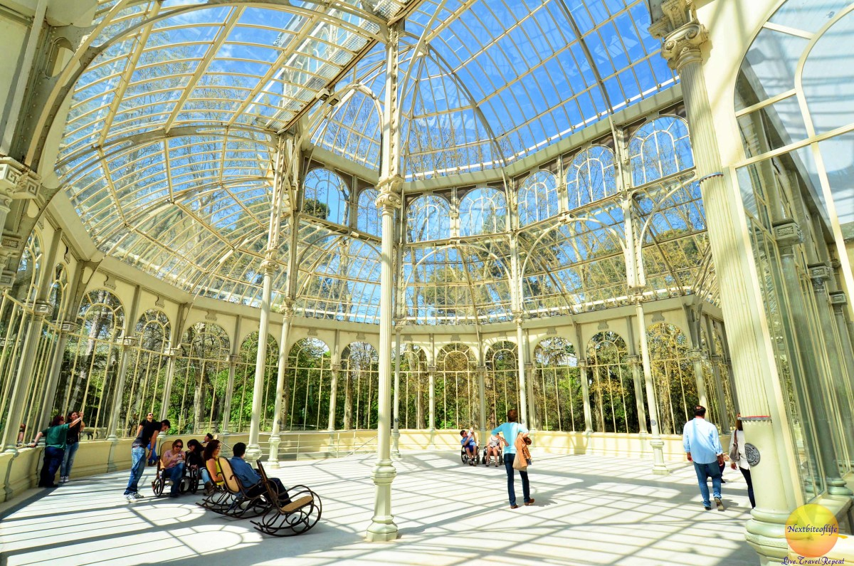 rocking chairs with people at crystal palace madrid