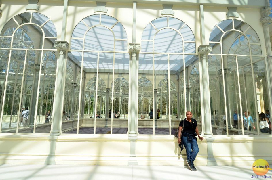 crystal palace madrid interior glass work with woman posing